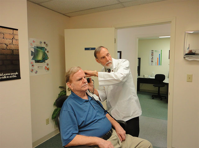 Man having ear checkup