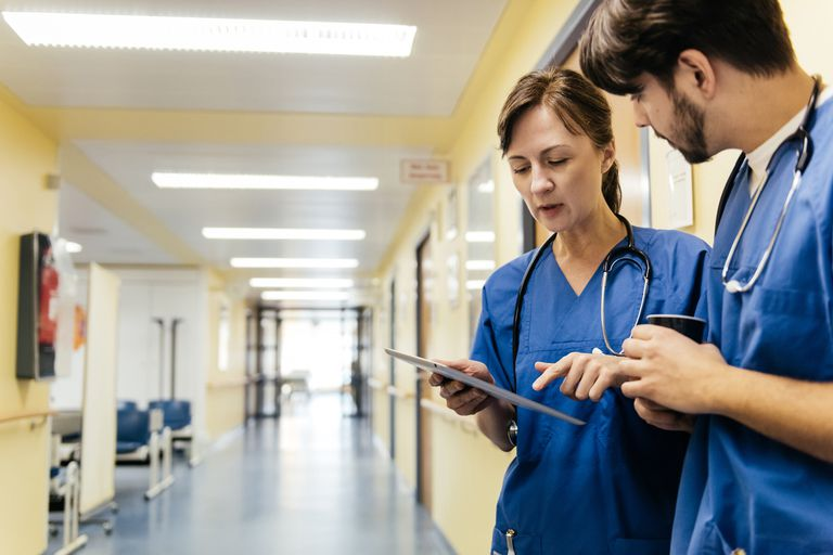 Two hospital workers standing in corridor