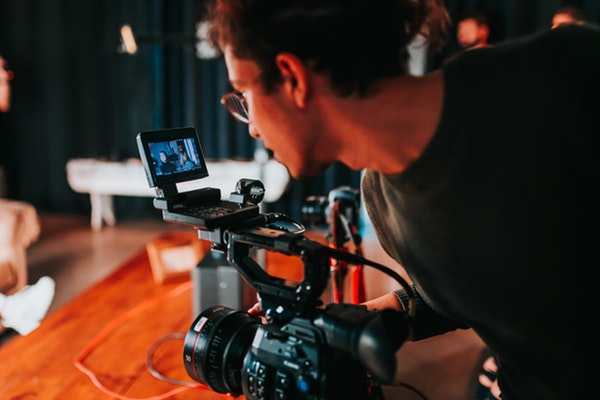 man filming a scene