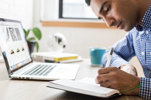 man using ballpoint pen
